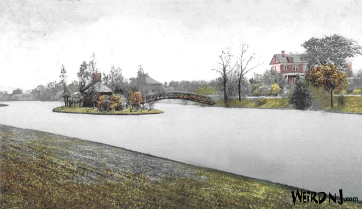 A vintage postcard of the stone house on Ross Lake Island showing a bridge (now gone) leading to the stately home of P. Sanford Ross.